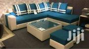 L Sofa, Glass Centre Table and 2 Poufs. | Furniture for sale in Central Region, Kampala